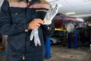 Auto mechanics closeup standing in his workshop
